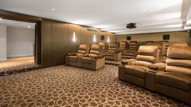 A private home theatre with comfy recliners.