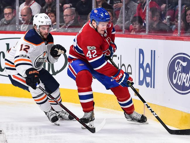 Nathan Walker, left, chases Byron Froese of the Montreal Canadiens while playing for the Edmonton Oilers. Photo: Minas Panagiotakis (Getty Images/AFP)