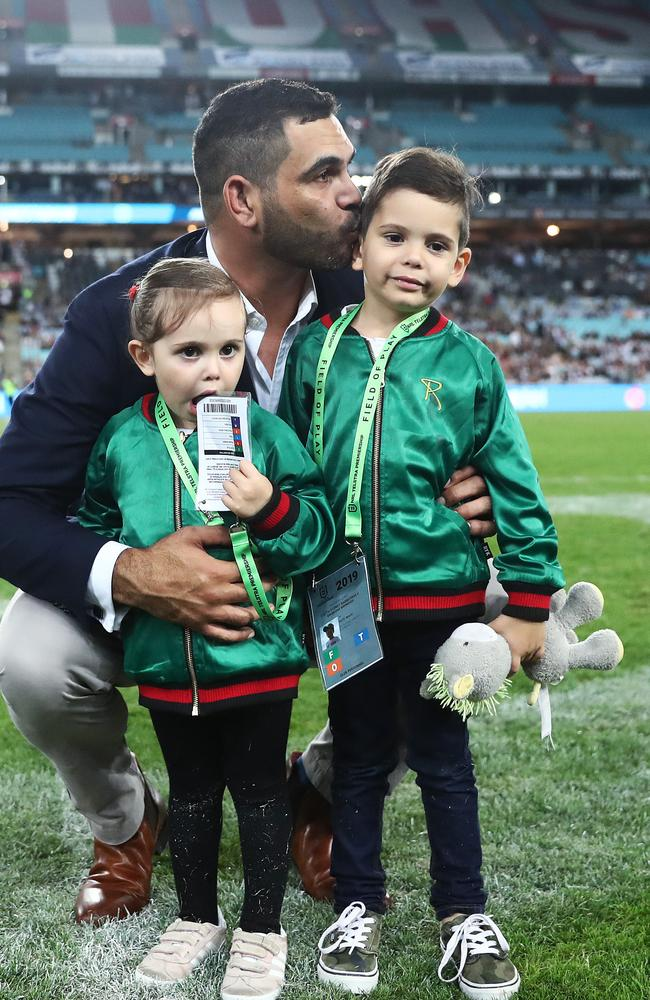 Greg Inglis with daughter Quinn and son Nate at his NRL farewell at ANZ Stadium. Picture. Phil Hillyard