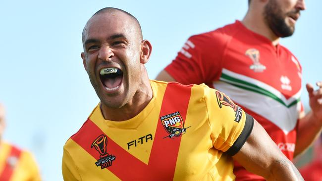 Papua New Guinea's Paul Aiton celebrates after scoring a try.