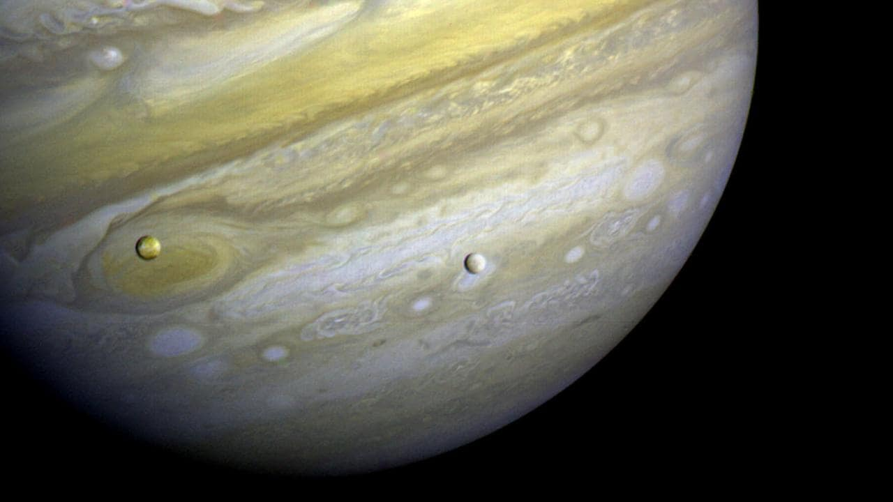 Jupiter and two of its moons, a photo taken by Voyager 2 in 1979. Picture: NASA/JPL