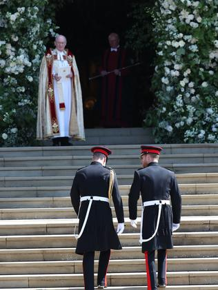 Prince Harry and Prince William enter the chapel. Picture: AFP