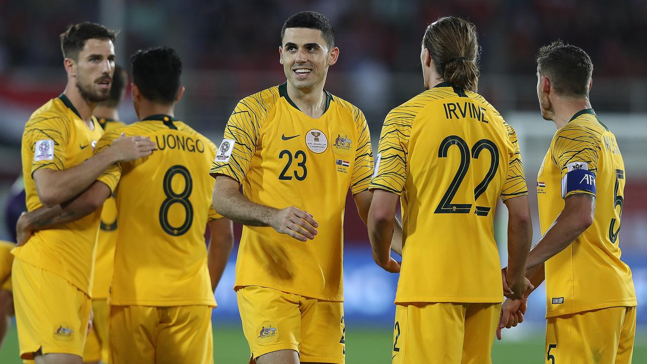 Tom Rogic (C) celebrates his sides second goal with Jackson Irvine and Mark Milligan