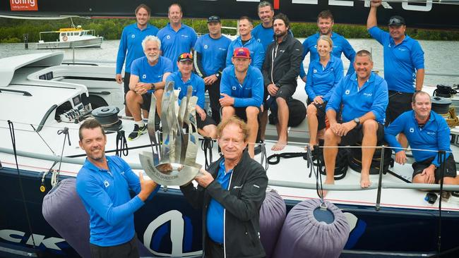 Skipper Mark Bradford and owner Peter Harburg in front of the victorious crew after  <i>Black Jack</i> broke the race record during the 70th Brisbane to Gladstone yacht race.