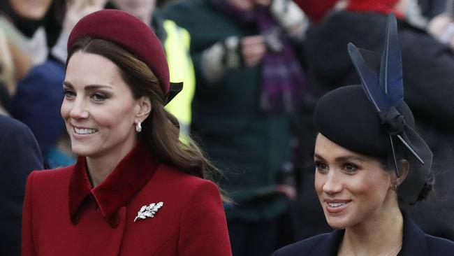 Kate and Meghan were all smiles leaving church on Christmas Day. Picture: Frank Augstein