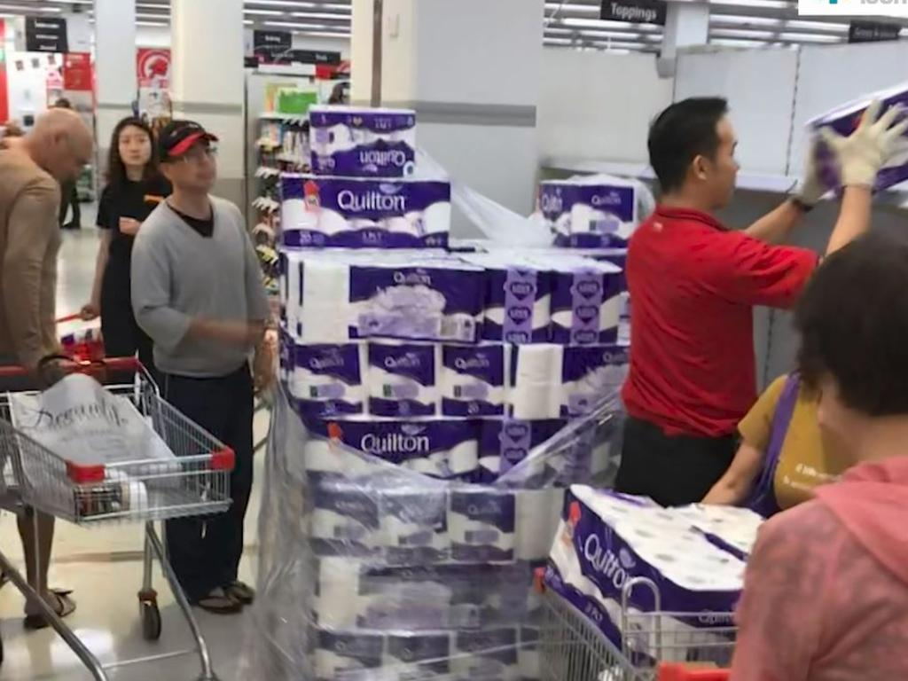 Customers don't wait for the shelves to be restocked at Coles in Broadway, Sydney. Picture: Chan Kwok Kei/Supplied.