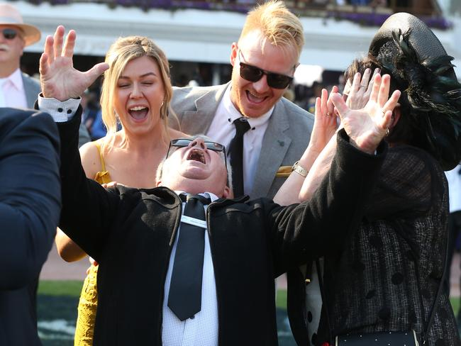 Damien Murnane shows his delight after becoming $250,000 richer when Mystic Journey won the 2019 All-Star Mile at Flemington. Picture: Michael Klein