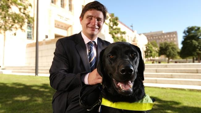 Paul Harpur, with his guide dog, is a disability rights advocate. Picture: Josh Woning.