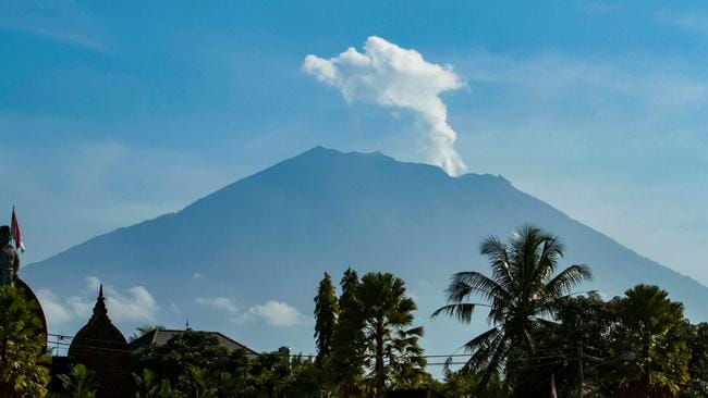 Mount Agung volcano spews steam and smoke into the air. Picture:AFP/Agus Ranu