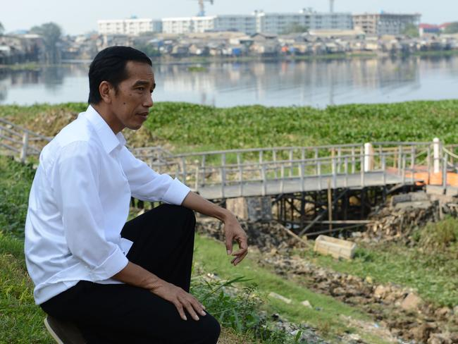Former Jakarta Governor Joko Widodo is from a humble family background and used to work as a furniture maker. Pic: AFP/ROMEO GACAD