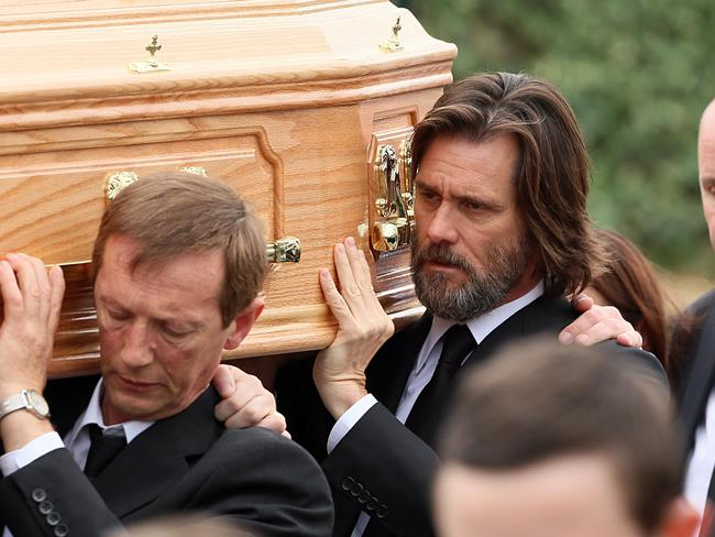 Jim Carrey carries the coffin of ex-girlfriend Cathriona. Picture: Splash News