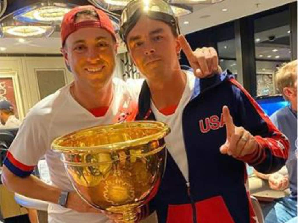 Justin Thomas and Rickie Fowler with the cup. It's hard to tell which side they were on.