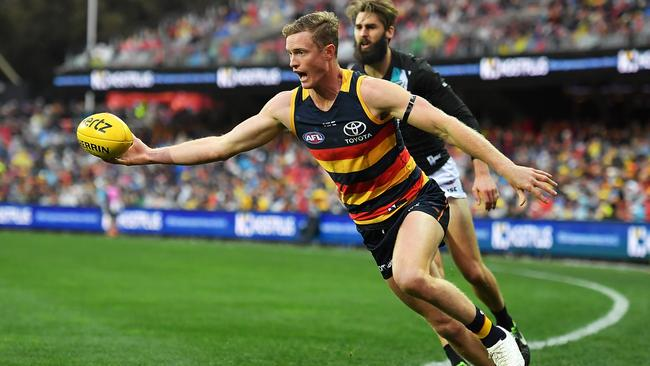 Jonathon Beech of the Crows keeps the ball in play.