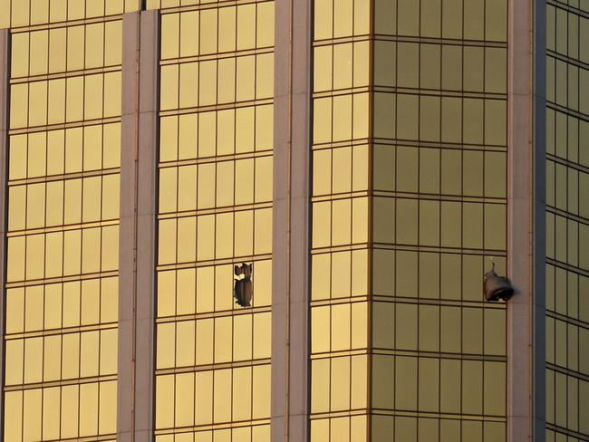 Drapes billow out of broken windows at the Mandalay Bay resort and casino on the Las Vegas Strip, following the deadly shooting. Picture: AP