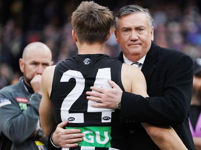 McGuire hugs Josh Thomas after the 2018 Grand Final loss.