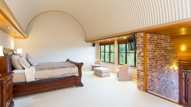 The arched ceilings continue in the bedroom.