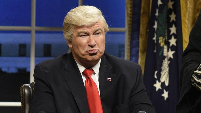 Alec Baldwin portrays US President Donald Trump in an opening sketch on  <i>Saturday Night Live </i>in 2017. The show premiered on this day in 1975.