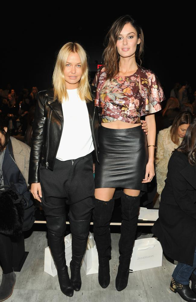 Models Lara Bingle (L) and Nicole Trunfio attend Zimmermann fashion show during Mercedes-Benz Fashion Week Fall 2014 in leather.