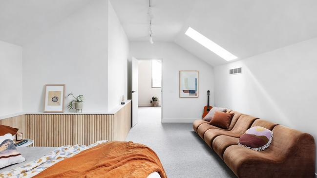 One of five bedrooms, with a clever skylight.