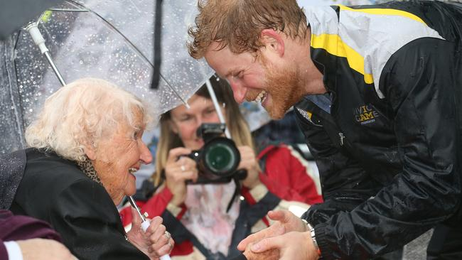 A drenched Prince Harry in 2017 made a beeline for war widow Daphne Dunne during his 2017 visit. Picture: Toby Zerna