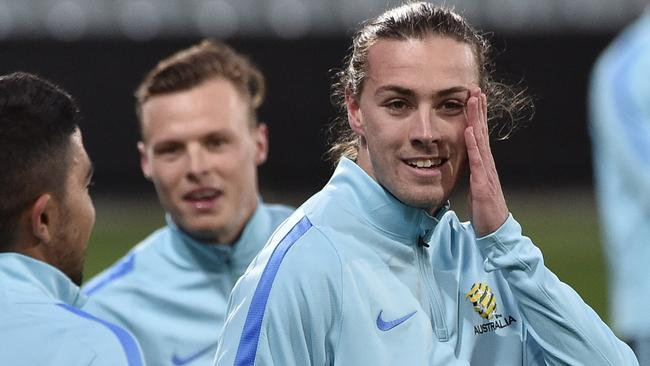 Socceroos player Jackson Irvine (right)