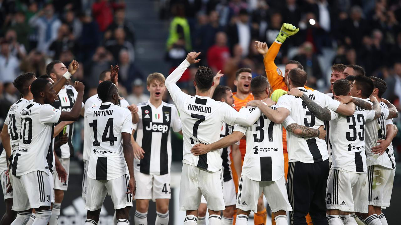 The Juventus players celebrate the win