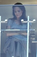 November 2014: Angelina is spotted looking as though she's been crying on a Sydney hotel balcony. Picture: INFphoto.com