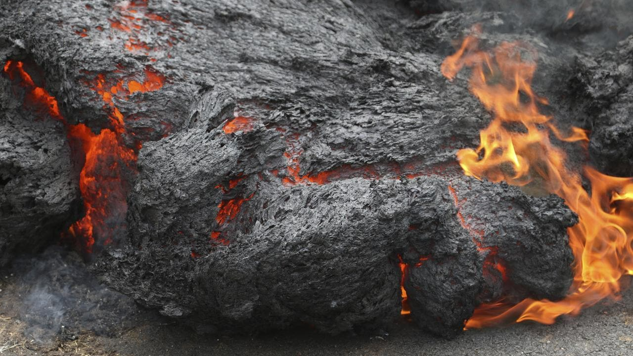 Lava burns across a road in Leilani Estates. Picture: AP