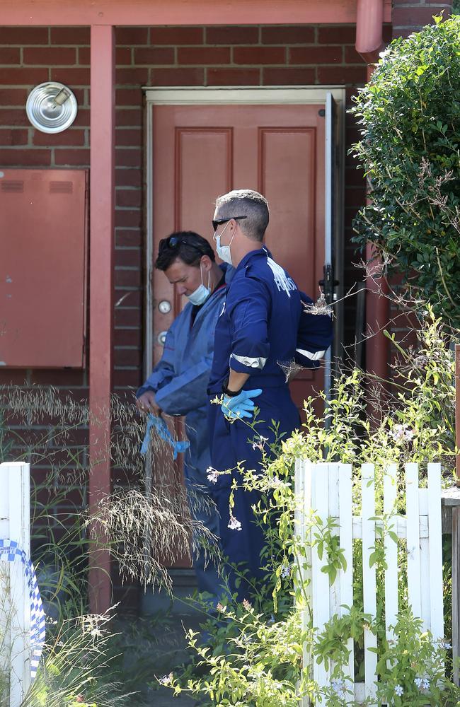 Forensics at the two-storey public housing property in Kensington, Melbourne. Picture: Yuri Kouzmin