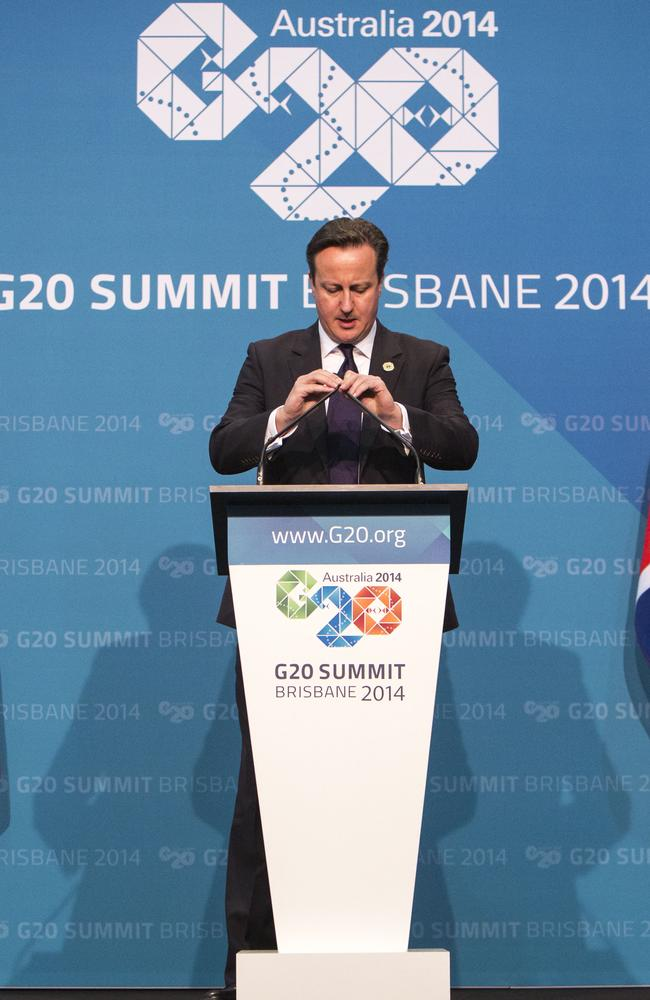 British Prime Minister David Cameron plays with the mic before speaking at the G20. Picture: Glenn Hunt / Getty