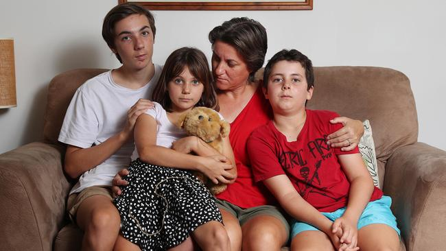 Catherine Frewer, widow of cyclist Cameron Frewer, with their three children Lachlan, Heidi and Oscar. Picture: Peter Wallis