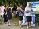 Queenslanders were urged to maintain a 1.5m distance when voting in local government elections.