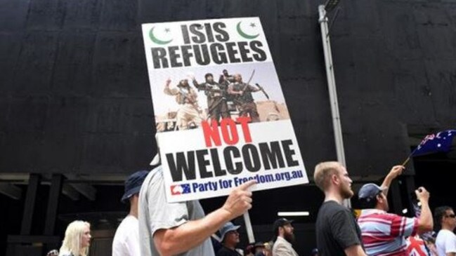 Protesters carried anti-Muslim signs to the protest but the Reclaim Australia numbers fit on a set of stairs in Martin Place. Picture: AAP.