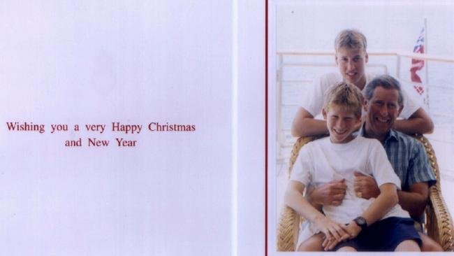 Prince Charles and his two sons, Prince William and Prince Harry, pose for their 1998 Christmas card.