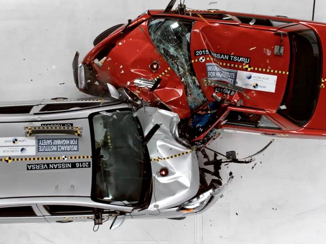 The roof and upper body structure of the new car (left) is undamaged, while the old model (right) is severely deformed through the roof and past the driver's seat. Picture: Supplied
