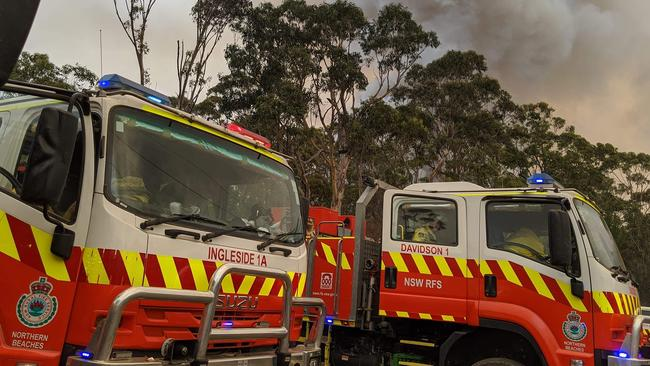 Rural Fire Brigade tankers from Ingleside and Davidson are pictured getting ready to battle fires on the NSW south coast. Picture: Ingleside RFS