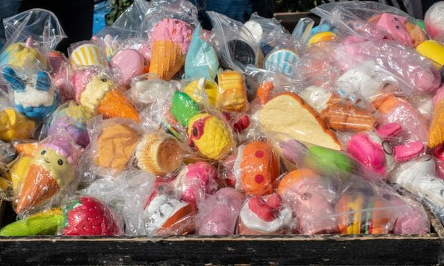 Heap of squishy toys on Rotterdam market in plastic in the sun