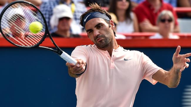 Roger Federer hits a return against Roberto Bautista Agut in their quarter-final.