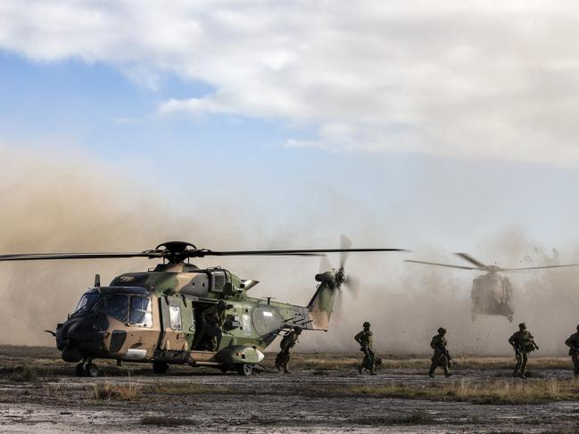 Australian Army soldiers of the 8th/9th Battalion, Royal Australian Regiment, arrive at Sabina Point, Shoalwater Bay Training Area, in MRH-90 helicopters. Picture: Defence
