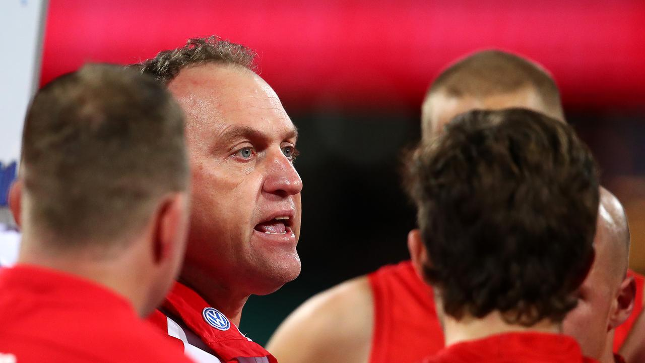 John Longmire talks to his players during a break against Hawthorn this year.