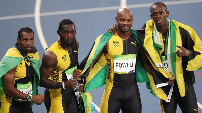 (l-r) Jamaica's Yohan Blake, Nickel Ashmeade, Asafa Powell and Usain Bolt celebrate after winning the gold medal in the Men's 4 x 100m Relay Final at the Rio Olympics.