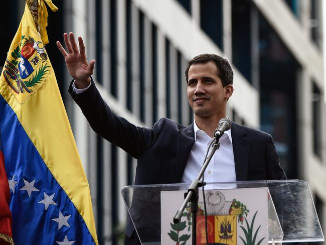 Juan Guaido waves to tens of thousands of supporters. Picture: Federico Parra