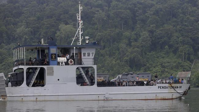 Final leg ... a ferry transfers Indonesian police vehicles carrying Chan and Sukumaran to Nusakambangan island.