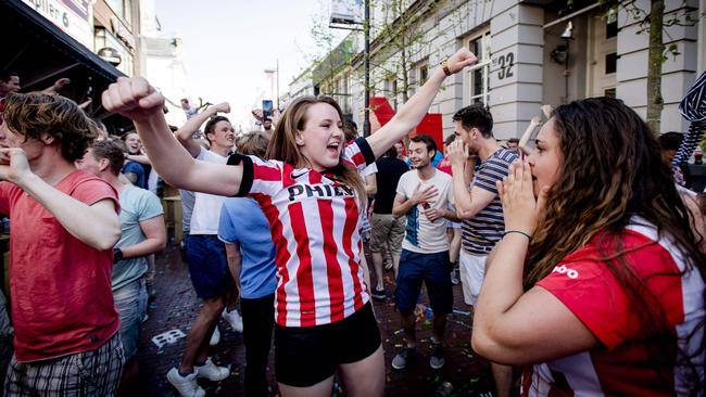 Fans of PSV Eindhoven celebrate in the street after their team won the Dutch league title.