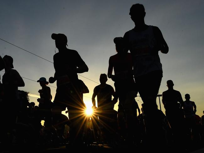 The sun rises as competitors begin the Marathon. Photo: Quinn Rooney/Getty Images