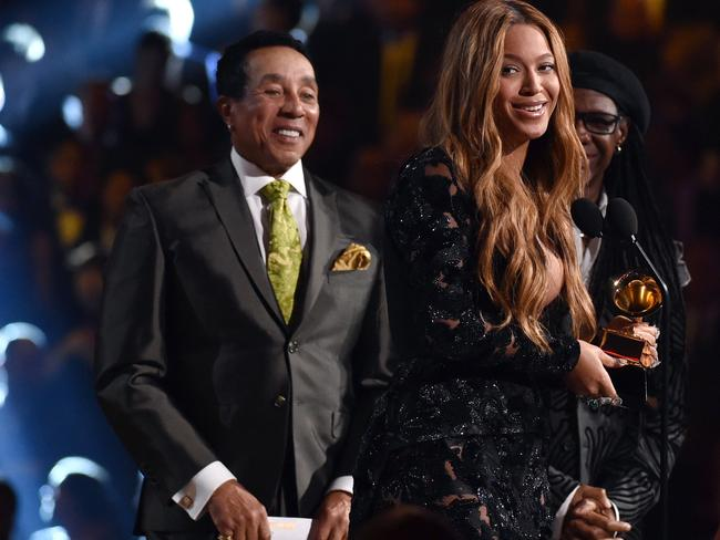 "Queen Bey ... Smokey Robinson, left, presents Beyonce with the award for best R & B performance for ""Drunk in Love"". Picture: John Shearer/Invision/AP"