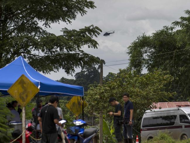 A Thai military helicopter flies over the Tham Luang cave area as operations continue for the eight boys and their coach still trapped at the cave in Khun Nam Nang Non Forest Park. Picture: AFP