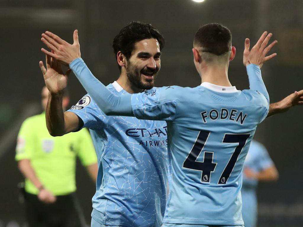Manchester City's German midfielder Ilkay Gundogan (L) celebrates after he scores his team's third goal with Manchester City's English midfielder Phil Foden  during the English Premier League football match between West Bromwich Albion and Manchester City at The Hawthorns stadium in West Bromwich, central England, on January 26, 2021. (Photo by Nick Potts / POOL / AFP) / RESTRICTED TO EDITORIAL USE. No use with unauthorized audio, video, data, fixture lists, club/league logos or 'live' services. Online in-match use limited to 120 images. An additional 40 images may be used in extra time. No video emulation. Social media in-match use limited to 120 images. An additional 40 images may be used in extra time. No use in betting publications, games or single club/league/player publications. /