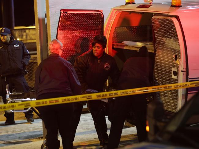 NYPD officers remove the bodies from the scene of the crash. Picture: Eduardo Munoz Alvarez/Getty Images/AFP