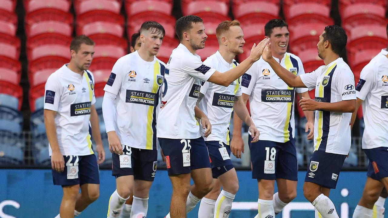 Central Coast Mariners players celebrate a goal